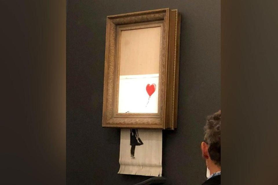The Banksy artwork was shredded in front of stunned bidders at a Sotheby's auction (PA)