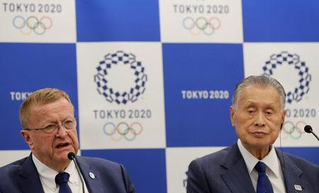FILE PHOTO: International Olympic Committee (IOC) Vice President John Coates and President of Tokyo 2020 Olympic and Paralympic organising committee Yoshiro Mori attend their news conference in Tokyo