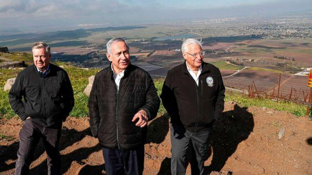 PHOTO: Sen. Lindsey Graham is accompanied by Israeli Prime minister Benjamin Netanyahu and U.S. Ambassador to Israel David Friedman as they visit the border line between Syria and the Israeli-annexed Golan Heights on March 11, 2019. (Pool via AFP/Getty Images)
