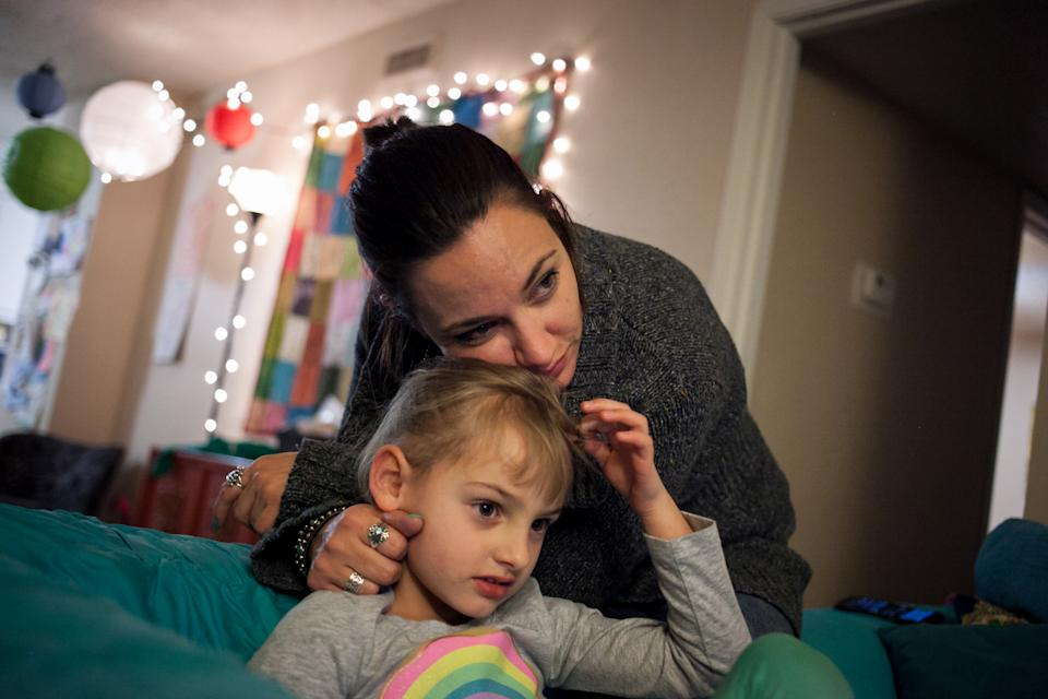 AUSTIN, TEXAS - FEBRUARY 13: Erin Meredith, 37, divorced and single mother of two children, including Addison, 5, works as an office manager in Bastrop, Texas. A self-described staunch Republican, Meredith has enrolled in Obamacare; she has a pre-existing genetic blood disorder. She votes a straight Republican ticket, and has faith that her elected officials will help her figure out her health care. I dont want a handout,  she says, I just want a little help. Meredith also said: Have faith in your State if you are going to send Washington home. I cant sacrifice my health, because Im the only one here. (Photo by Ilana Panich-Linsman for The Washington Post via Getty Images)