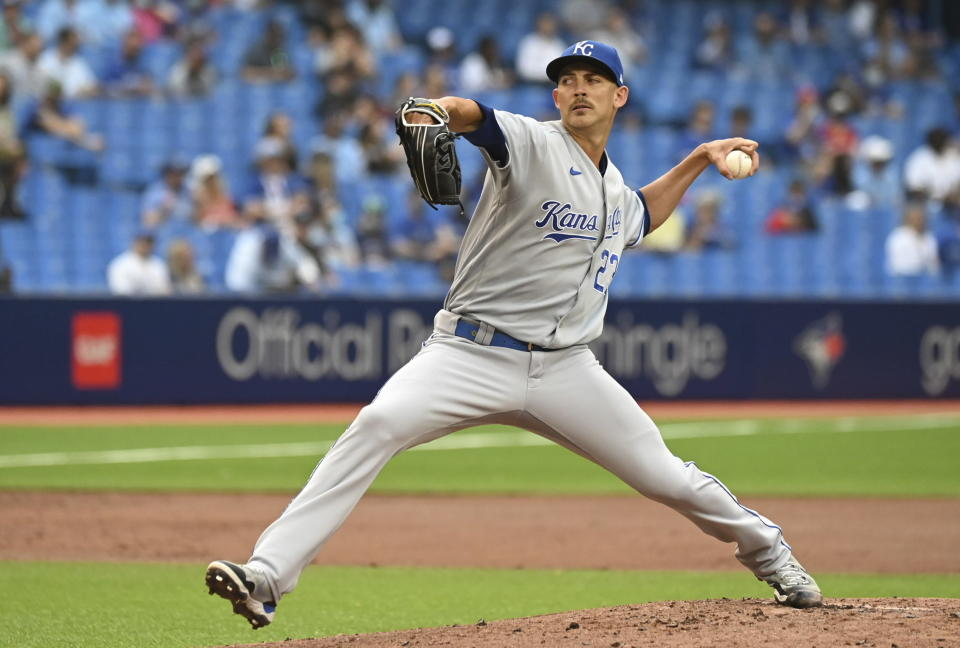 Kansas City Royals' Mike Minor pitches during the first inning of baseball action against the Toronto Blue Jays in Toronto on Saturday, July 31, 2021. (Jon Blacker/The Canadian Press via AP)