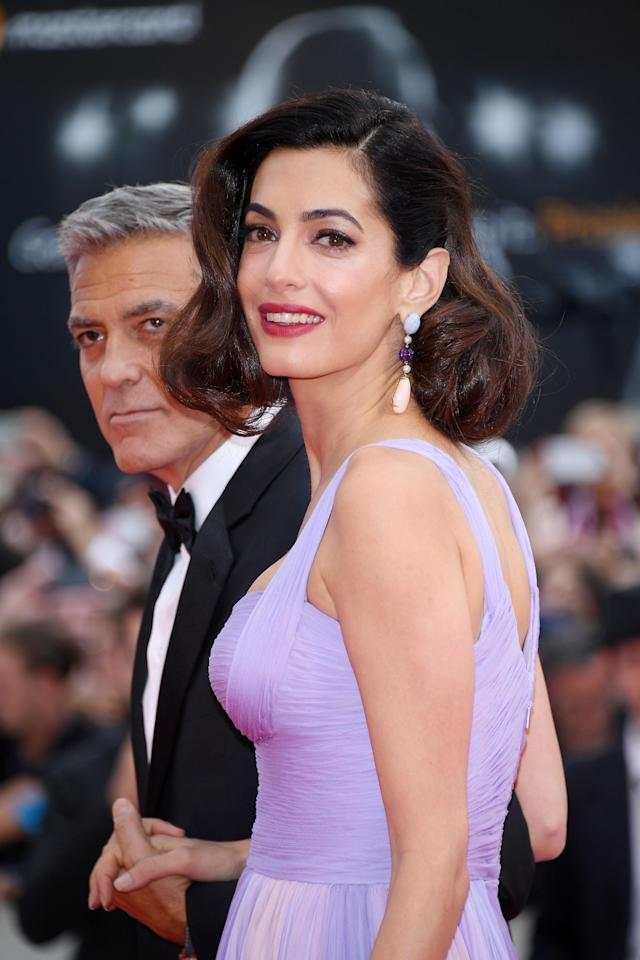George and Amal Clooney on the Venice Film Festival red carpet. (Photo: Daniele Venturelli)
