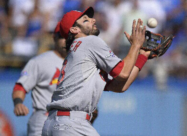 St. Louis Cardinals' Matt Carpenter catches a ball hit by Los Angeles Dodgers' Nick Punto during the second inning of Game 5 of the National League baseball championship series, Wednesday, Oct. 16, 2013, in Los Angeles. (AP Photo/Mark J. Terrill)