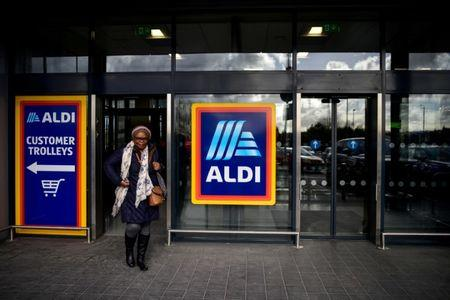 FILE PHOTO: A shopper leaves an Aldi store in London, Britain February 15, 2018. REUTERS/Peter Summers/File Photo