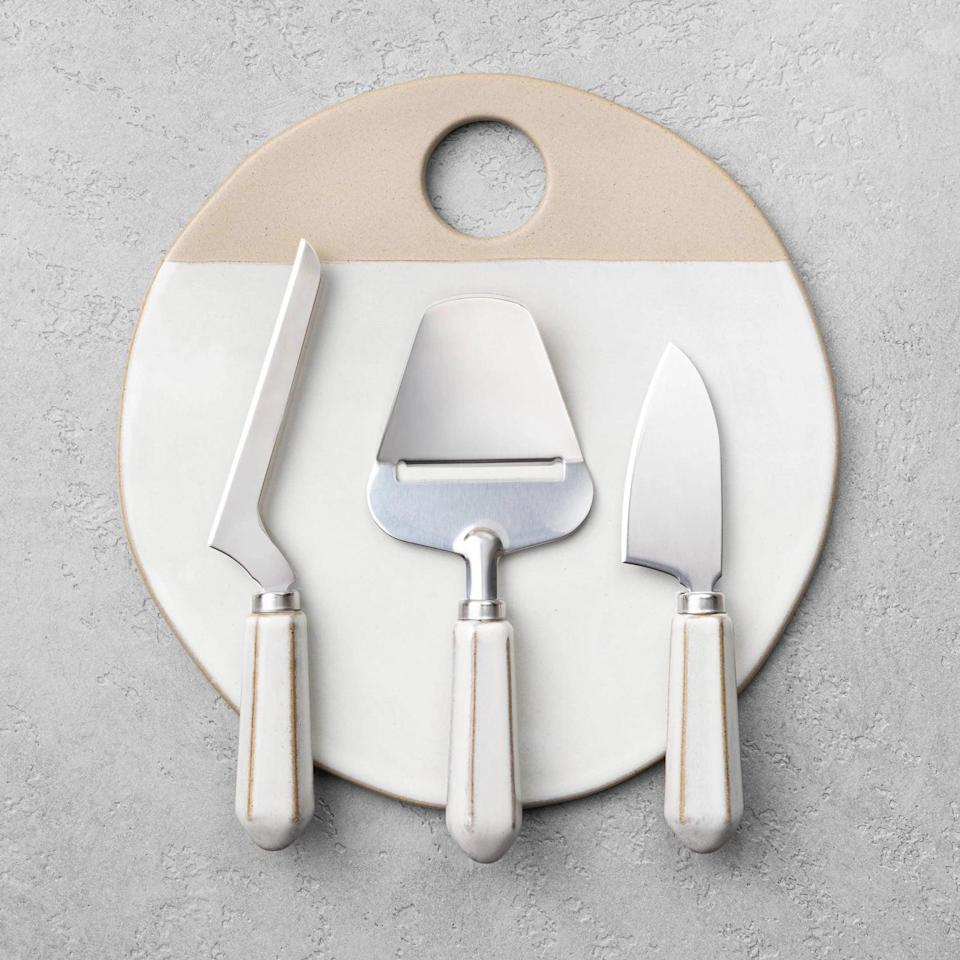 <p>Level up their cheese and wine nights with this <span>Hearth &amp; Hand with Magnolia Board &amp; Cheese Knife Set</span> ($25).</p>
