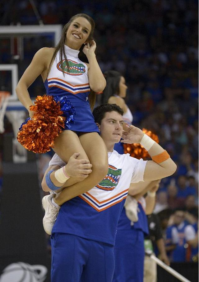 Florida cheerleaders perform during the second half in a third-round game in the NCAA college basketball tournament against Pittsburgh, Saturday, March 22, 2014, in Orlando, Fla. (AP Photo/Phelan M. Ebenhack)