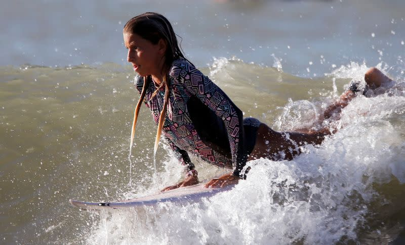 Inspired by Brazil's gold medalist Italo Ferreira, 12-year-old Maria Clara, surfs the waves and dreams of an Olympic career