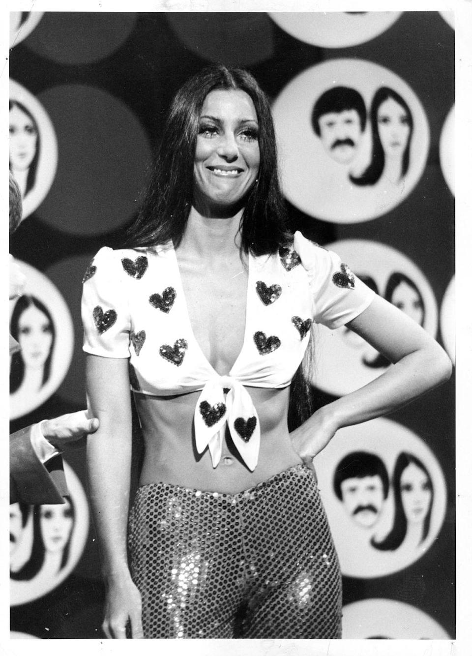 <p>Wearing a heart-printed crop top and sequin pants for a segment on the <em>Sonny and Cher</em> show.</p>