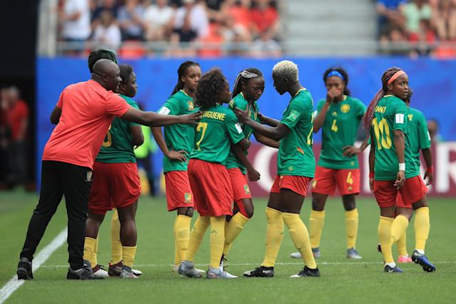 Cameroon Head Coach Alain Djeumfa reacts among his players after a VAR decision goes against them. (Photo by Marc Atkins/Getty Images)