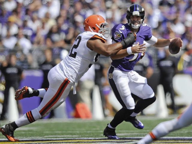 Baltimore Ravens quarterback Joe Flacco (5) is pulled down by Cleveland Browns defensive end Desmond Bryant, left, during the first half of an NFL football game in Baltimore, Md., Sunday, Sept. 15, 2013. (AP Photo/Nick Wass)