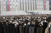 People watch the national flag raising ceremony and fireworks display to celebrate the New Year, at Kim Il Sung Square in Pyongyang, North Korea, early Friday, Jan., 1, 2021. (AP Photo/Jon Chol Jin)