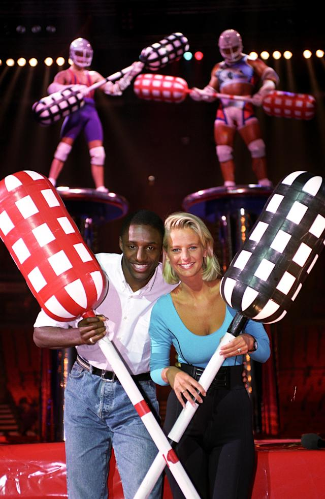 Ulrika Jonsson and John Fashanu on the set of <em>Gladiators</em>. (David Jones – PA Images/PA Images via Getty Images)