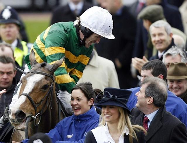 Champ, named in honour of AP McCoy, triumphed in the Novices Chase (AFP Photo/GLYN KIRK)