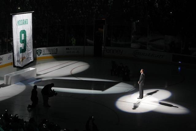 Former Dallas Stars player Mike Modano watches as a banner bearing his jersey number is raised before the Stars' NHL hockey game against the Minnesota Wild, Saturday, March 8, 2014, in Dallas. (AP Photo/ Richard W. Rodriguez)