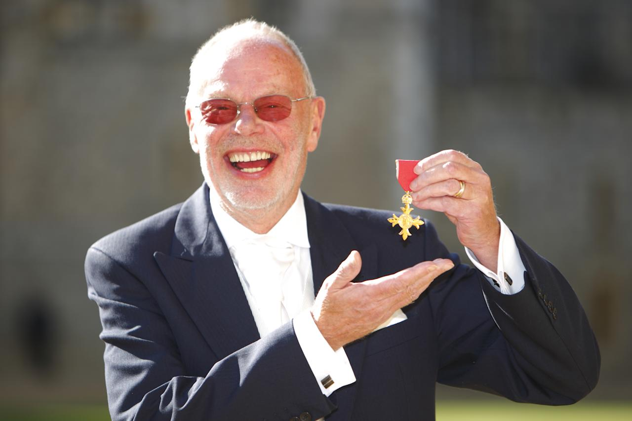 WINDSOR, ENGLAND - OCTOBER 20:  Radio DJ 'Whispering' Bob Harris poses after receiving his Officer of the British Empire (OBE) from the Princess Anne, Princess Royal at Windsor Castle on October 20, 2011 in Windsor, England.  (Photo by Chris Ison - WPA/Getty Images)