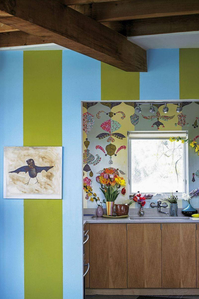 """<p>For his upstate New York country house that he shares with his partner, Tony Longoria, designer Todd Oldham applied 20 coats of glaze to the wall behind the <a href=""""https://www.elledecor.com/design-decorate/room-ideas/g3486/best-kitchen-design/"""" rel=""""nofollow noopener"""" target=""""_blank"""" data-ylk=""""slk:kitchen sink"""" class=""""link rapid-noclick-resp"""">kitchen sink</a>. He then decorated it with cutouts of Japanese silk-screened papers for a dramatic effect.</p><p><em>Blue and Green Stripe Wallpaper, $72</em><br><a class=""""link rapid-noclick-resp"""" href=""""https://www.spoonflower.com/wallpaper/4714575-blue-green-stripe-by-ileneavery?gclid=CjwKCAjw8NfrBRA7EiwAfiVJpVT6-_fZO8aZPXQZiWi4N95mCLTG_zaLrBYkFRoqAsQuJkIKBMG9VBoC994QAvD_BwE"""" rel=""""nofollow noopener"""" target=""""_blank"""" data-ylk=""""slk:Shop the Look"""">Shop the Look</a></p>"""
