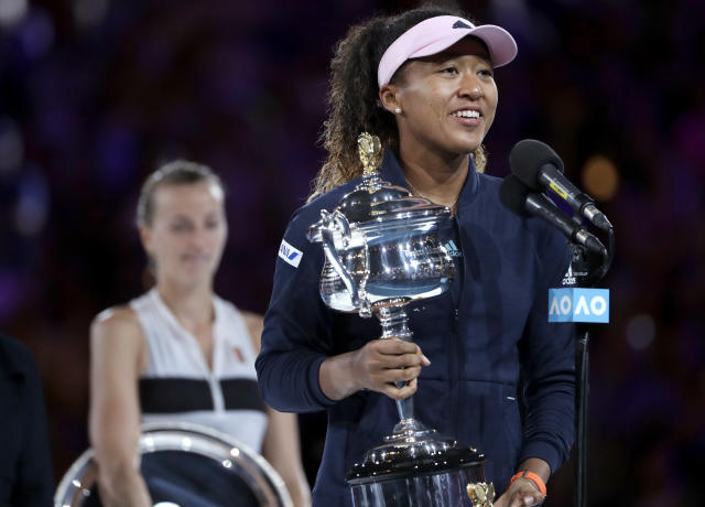 Japan's Naomi Osaka holds her trophy after defeating Petra Kvitova, left, of the Czech Republic during the women's singles final at the Australian Open tennis championships in Melbourne, Australia, Saturday, Jan. 26, 2019. (AP Photo/Mark Schiefelbein)