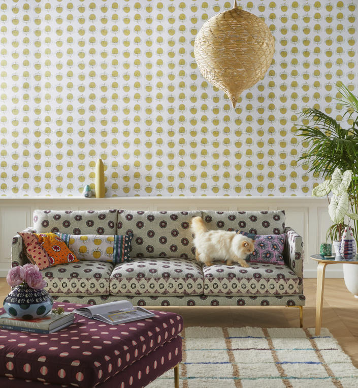 This undated photo provided by Anthropologie shows the Linde sofa, a collaborative collection with luxury lifestyle brand SUNO. Featuring a geometric print and cast iron legs, the sofa has a chic yet relaxed midmod Italian profile. (Anthropologie via AP)