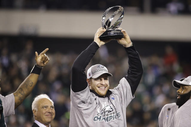 The Eagles' Carson Wentz holds the George Halas Trophy after the NFC championship game against the Minnesota Vikings on Sunday, Jan. 21, 2018, in Philadelphia. (AP Photo/Matt Rourke)