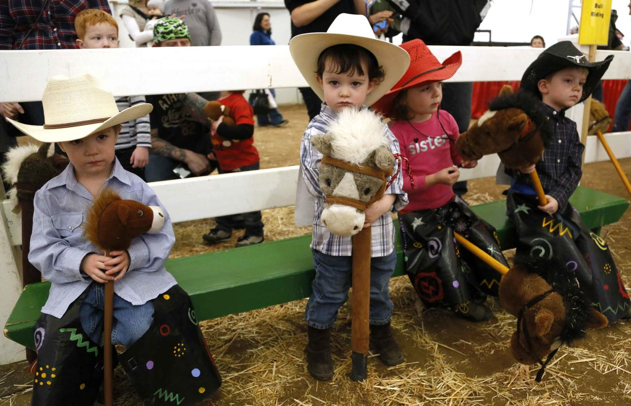 Children wait to compete in the stick horse rodeo at the 108th National Western Stock Show in Denver