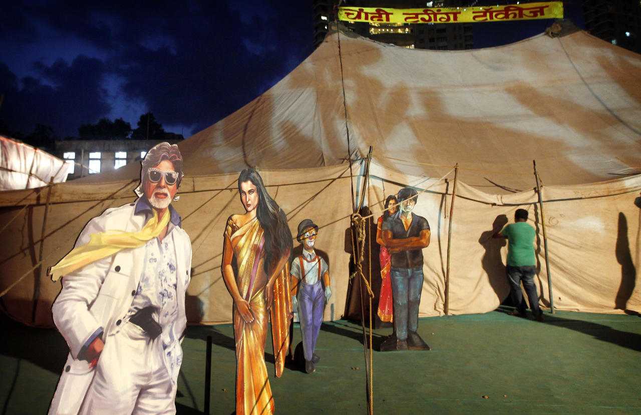 "In this April 20, 2013 photo, cut outs of Indian Bollywood stars are displayed on the premises of the Anup Touring Talkies tent cinema in Mumbai, India. Friday, May 3 marks exactly a hundred years after India's first feature film ""Raja Harischandra,"" a silent movie, was screened in 1913. India produced almost 1,500 movies last year and the industry is expected to grow from $ 2 billion to $ 3.6 billion in the next five years, according to consultancy KPMG. (AP Photo/Rajanish Kakade)"