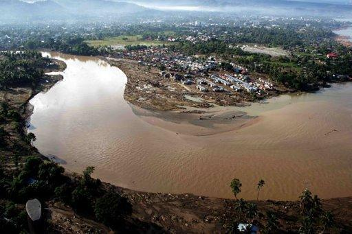 An aerial picture shows the damge caused by devastating floods over Iligan City. The death toll from a destructive storm that hit the southern Philippines has risen to 927 as bodies surfaced in the sea, the head of the government disaster monitoring council said Tuesday