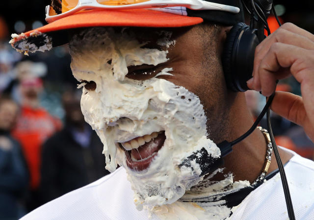 Baltimore Orioles' Nelson Cruz reacts after teammate Adam Jones smeared a pie in his face during a postgame television interview after an opening day baseball game against the Boston Red Sox, Monday, March 31, 2014, in Baltimore. Baltimore won 2-1 on a solo home run by Cruz. (AP Photo/Patrick Semansky)