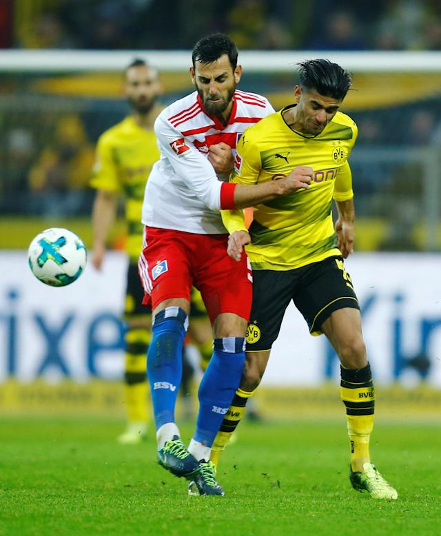 Soccer Football - Bundesliga - Borussia Dortmund vs Hamburger SV - Signal Iduna Park, Dortmund, Germany - February 10, 2018 Hamburg's Mergim Mavraj in action with Borussia Dortmund's Mahmoud Dahoud REUTERS/Leon Kuegeler DFL RULES TO LIMIT THE ONLINE USAGE DURING MATCH TIME TO 15 PICTURES PER GAME. IMAGE SEQUENCES TO SIMULATE VIDEO IS NOT ALLOWED AT ANY TIME. FOR FURTHER QUERIES PLEASE CONTACT DFL DIRECTLY AT + 49 69 650050