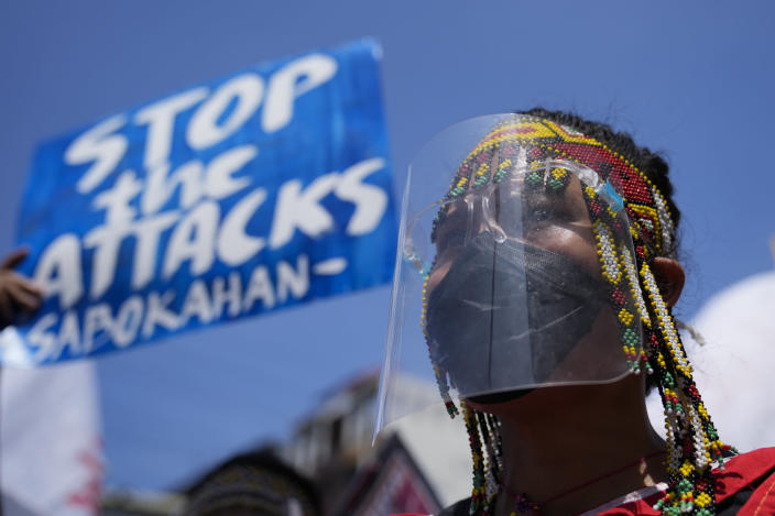 A protester wearing a traditional dress joins a rally outside the Malacanang palace in Manila, Philippines on Wednesday, June 30, 2021. The group has called for justice and accountability for the thousands who have died due to the government's anti-drug crackdown under the administration of Philippine President Rodrigo Duterte. (AP Photo/Aaron Favila)