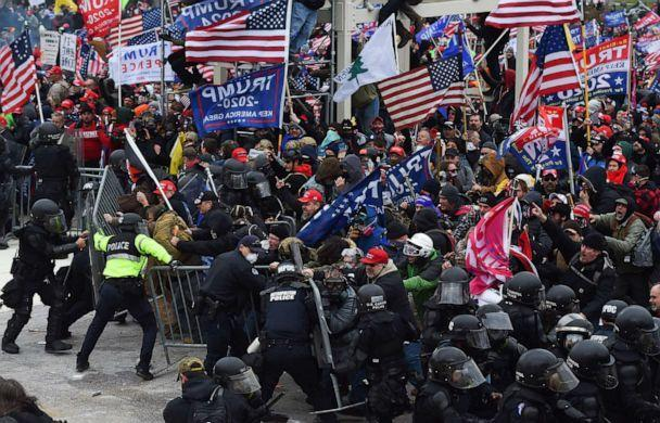 PHOTO: Trump supporters clash with police and security forces as they push barricades to storm the US Capitol in Washington D.C., Jan. 6, 2021. (Roberto Schmidt/AFP via Getty Images, FILE)