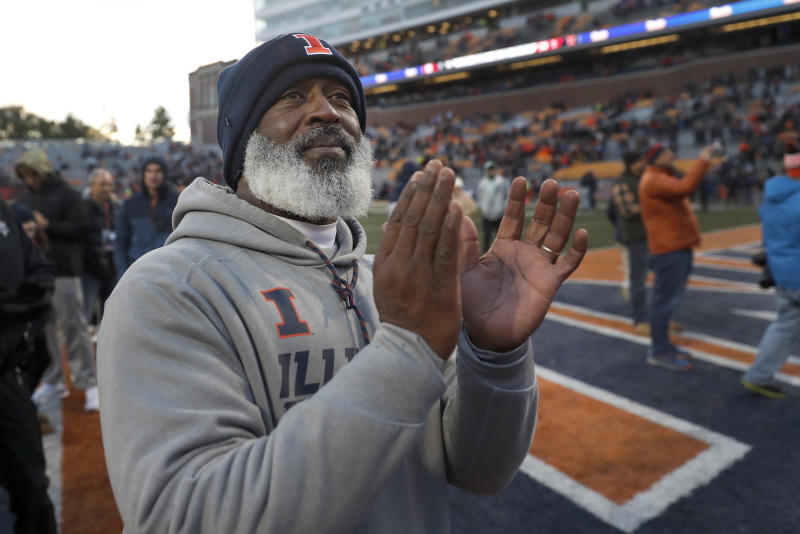 Illinois head coach Lovie Smith applauds the marching band after his team's 38-10 win over Rutgers after an NCAA college football game Saturday, Nov. 2, 2019, in Champaign, Ill. (AP Photo/Charles Rex Arbogast)
