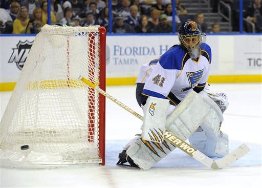 St. Louis Blues goalie Jaroslav Halak, of Slovakia, deflects a shot on goal by the Tampa Bay Lighting during the second period of an NHL hockey game, Saturday, March 17, 2012, in Tampa, Fla. (AP Photo/Brian Blanco)