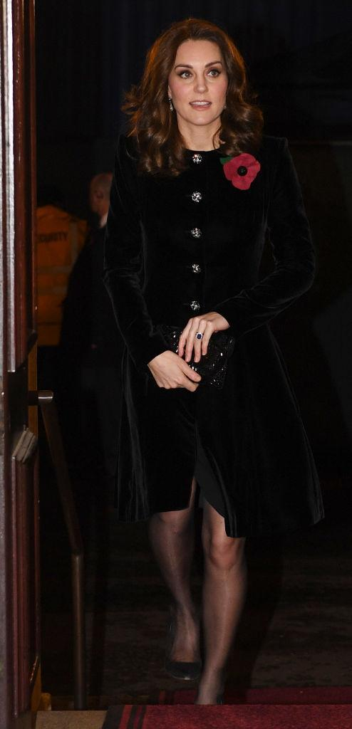 <p>The Duchess of Cambridge donned a velvet Catherine Walker coat with Swarovski buttons to the Festival of Remembrance. <em>[Photo: Getty]</em> </p>