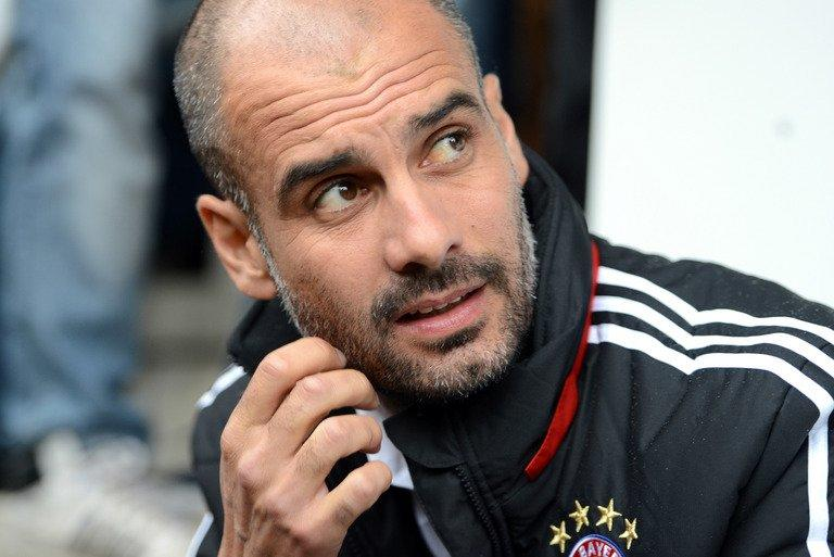Pep Guardiola watches a training session in Weiden, southern Germany on June 29, 2013