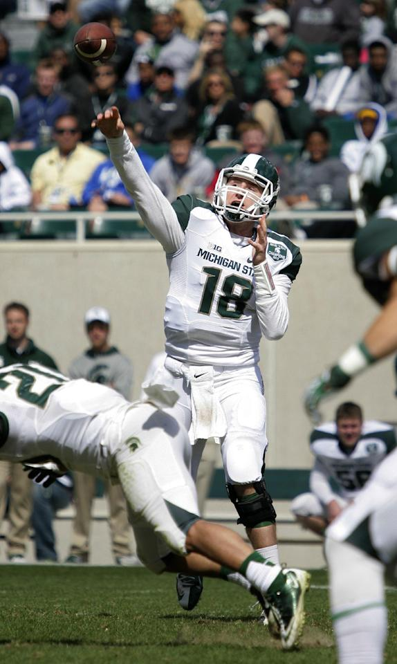 White team quarterback Connor Cook (18) throws a pass against the Green team during Michigan State's NCAA college spring football scrimmage on Saturday, April 26, 2014, in East Lansing, Mich. The White team won 20-13. (AP Photo/Al Goldis)