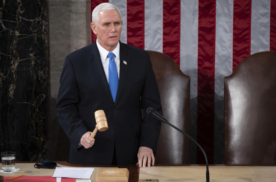 Vice President Mike Pence officiates as a joint session of the House and Senate convenes to confirm the Electoral College votes cast in November's election, at the Capitol in Washington, Wednesday, Jan. 6, 2021. (Saul Loeb/Pool via AP)