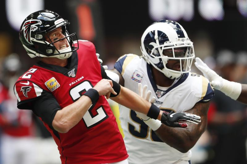 Atlanta Falcons quarterback Matt Ryan (2) works in the pocket against the Los Angeles Rams during the first half of an NFL football game, Sunday, Oct. 20, 2019, in Atlanta. (AP Photo/John Bazemore)