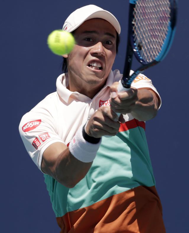 Kei Nishikori, of Japan, returns to Dusan Lajovic, of Serbia, during the Miami Open tennis tournament, Friday, March 22, 2019, in Miami Gardens, Fla. (AP Photo/Lynne Sladky)