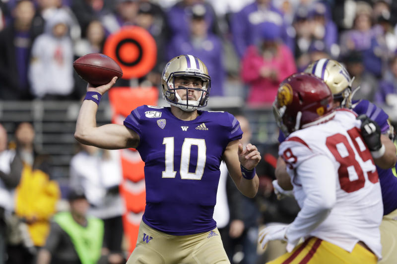 Washington quarterback Jacob Eason sets up to pass against Southern Cal in the first half of an NCAA college football game Saturday, Sept. 28, 2019, in Seattle. (AP Photo/Elaine Thompson)