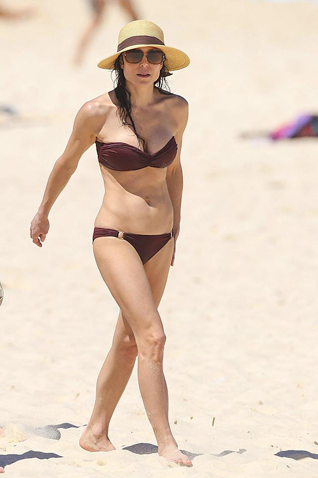 February 19, 2013: Bethenny Frankel takes a surfing lesson on Sydney's Bondi Beach, Bethenny showed off her bikini body, Sydney, Australia.