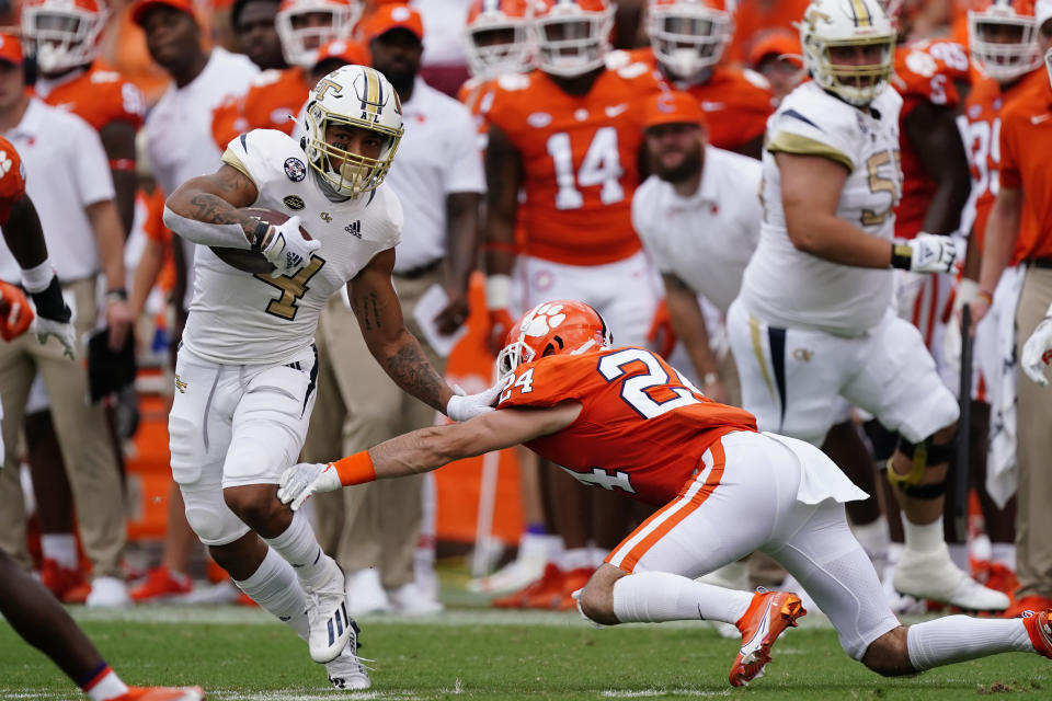 Georgia Tech running back Dontae Smith (4) tries to get away from Clemson linebacker Trenton Simpson (22) after a catch in the first half of an NCAA college football game Saturday, Sept. 18, 2021, in Clemson, S.C. (AP Photo/John Bazemore)