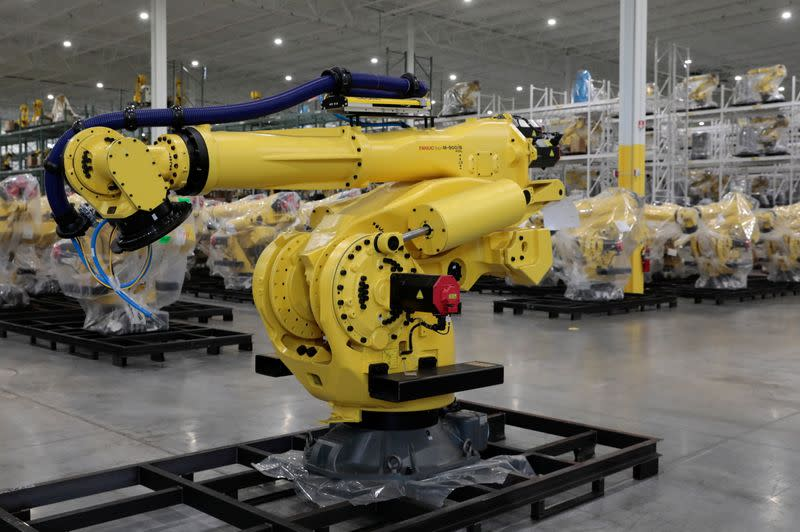 An inventory of manufacturing robots, waiting to be shipped to customers are seen in a FANUC American facility