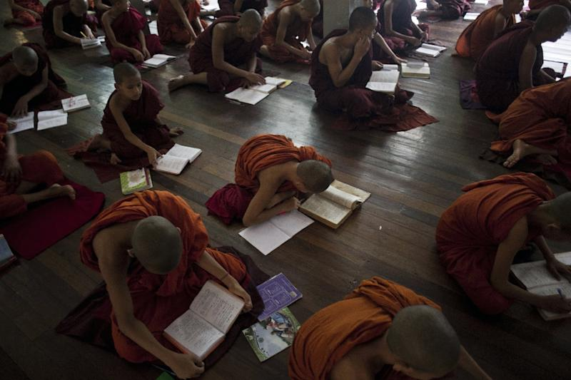 Myanmar Buddhist monks study at a monastery in Myanmar's second biggest city of Mandalay, on August 26, 2015 (AFP Photo/Ye Aung Thu)