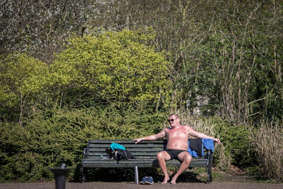 """A man sunbathes in Regents Park in London on March 25. <p class=""""copyright"""">Getty</p>"""