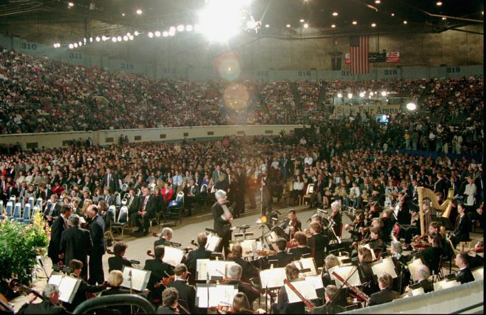 FILE - In this Sunday, April 23, 1995 file photo, a capacity crowd attends the prayer service at the State Fair Area in Oklahoma City for the victims of Wednesday's fatal car-bombing of the Alfred P. Murrah Federal Building in downtown Oklahoma City. (AP Photo/Wilfredo Lee)
