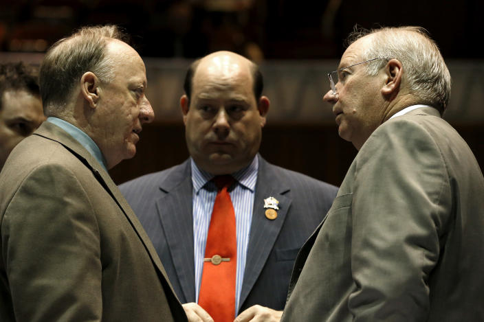 House Speaker Rep. Andy Tobin, R-Paulden, right, talks with Majority Whip Rep. Rick Gray, R-Sun City, left, and Majority Leader Rep. David Gowan, Sr., R-Sierra Vista, in a special session budget battle for Medicaid funding on Wednesday, June 12, 2013, in Phoenix. The Arizona Legislature is on track to pull an all-nighter and work into Thursday to finish a state budget and approve Medicaid expansion. (AP Photo/Ross D. Franklin)
