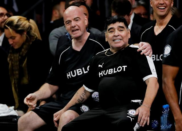 Soccer Football - Hublot Match of Friendship - Congress Center, Basel, Switzerland - March 21, 2018 Diego Maradona and member of Team Diego Maradona, FIFA president Gianni Infantino during the match REUTERS/Arnd Wiegmann