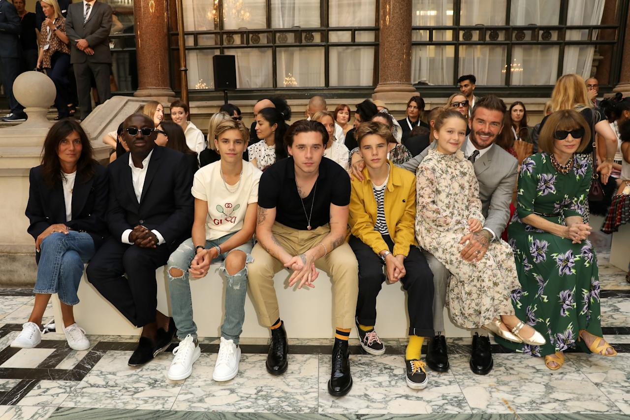 Emmanuelle Alt, Edward Enninful, Romeo Beckham, Brooklyn Beckham, Cruz Beckham, Harper Beckham, David Beckham and Anna Wintour attend the Victoria Beckham show during London Fashion Week September 2019 at British Foreign and Commonwealth Office on September 15, 2019 in London, England. Photo courtesy of Getty Images.