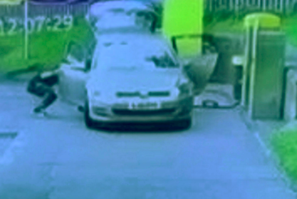 The woman was cleaning the interior of the VW Golf when the thief got in the car and sped off. (SWNS)