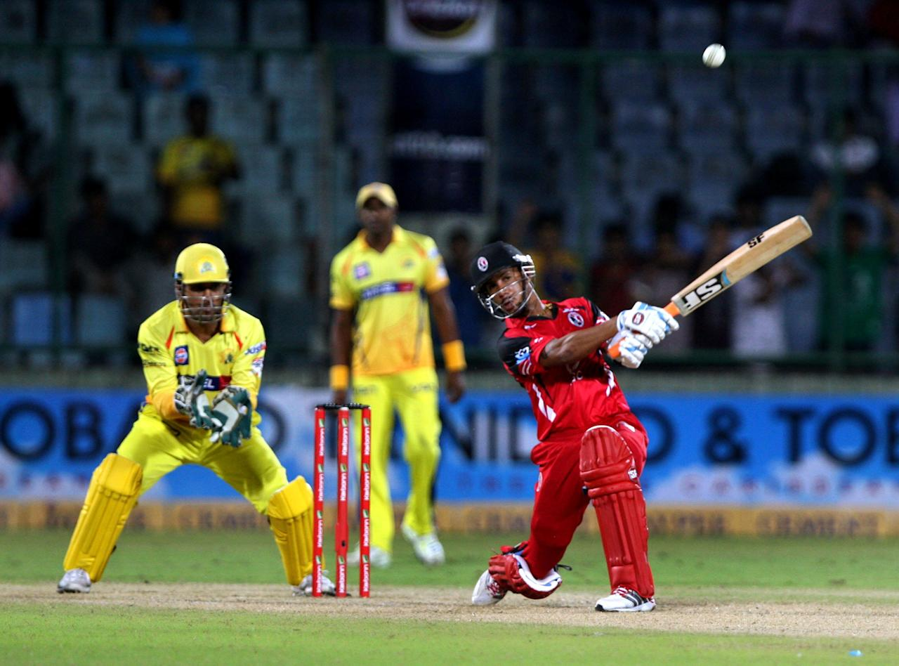 T&T's Lendl Simmons plays a shot during the CLT20 match between Chennai Super Kings and Trinidad & Tobago at Feroz Shah Kotla, Delhi on Oct. 2, 2013. (Photo: IANS)
